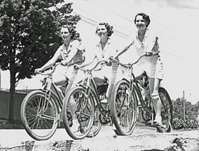 Three girls on bicycles at Ramona Cycle Club