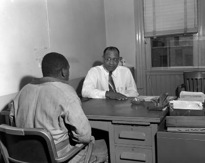 Walter Coe, detective, at work