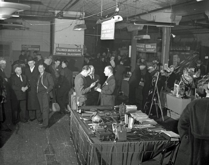 Electric Supply Co. open house crowd & display