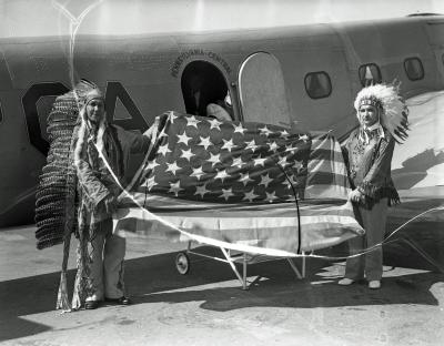 Native Americans with flag at airport
