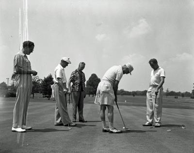 G. E. Supply Corp., foursome on putting green at Cascade C.C.