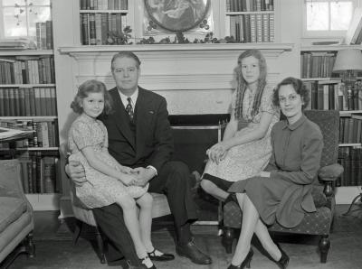 Mr. & Mrs. Thos. McAllister and family at home