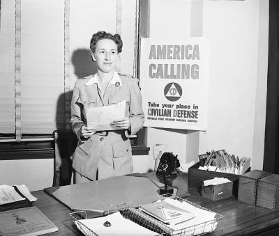 Mrs. Russell Fouts at her desk, Civil Defense