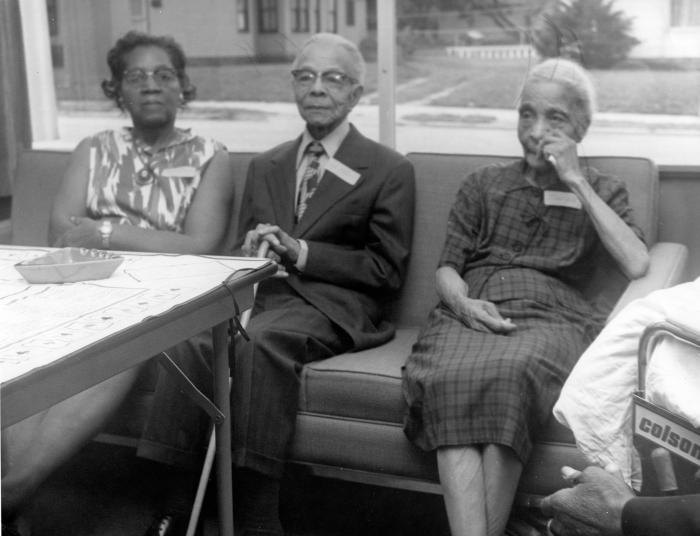 Three seated senior citizens