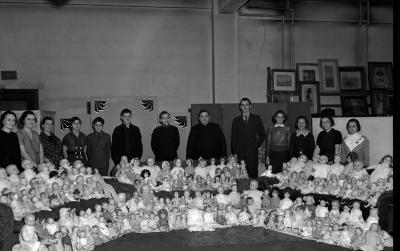 Salvation Army, Group working on dolls