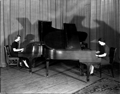 Girls at pianos
