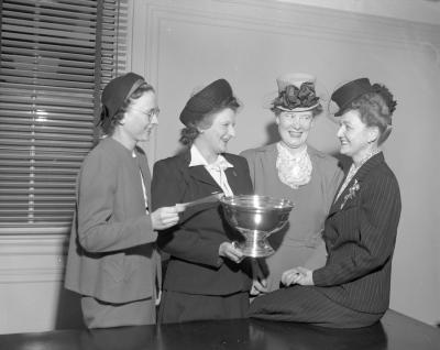 Accountants, women with trophy
