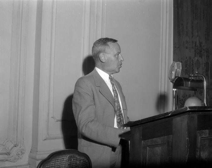 Amberg, Julius, speaking to Rotary