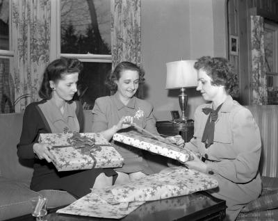 Attwood family wrapping presents for soldiers