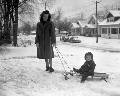 Mrs. William Snyder and daughter in snow