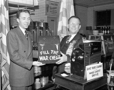 Banquet Barbecue, Tony Zoavas Presenting Day's Receipts to War Chest