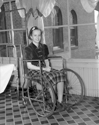 Barker, Cora in wheelchair