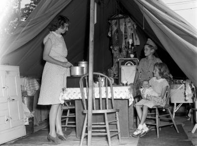 Housing shortage-family living in tent