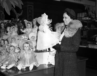 Christmas gifts, woman with doll