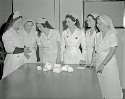 Red Cross, making bandages at headquarters
